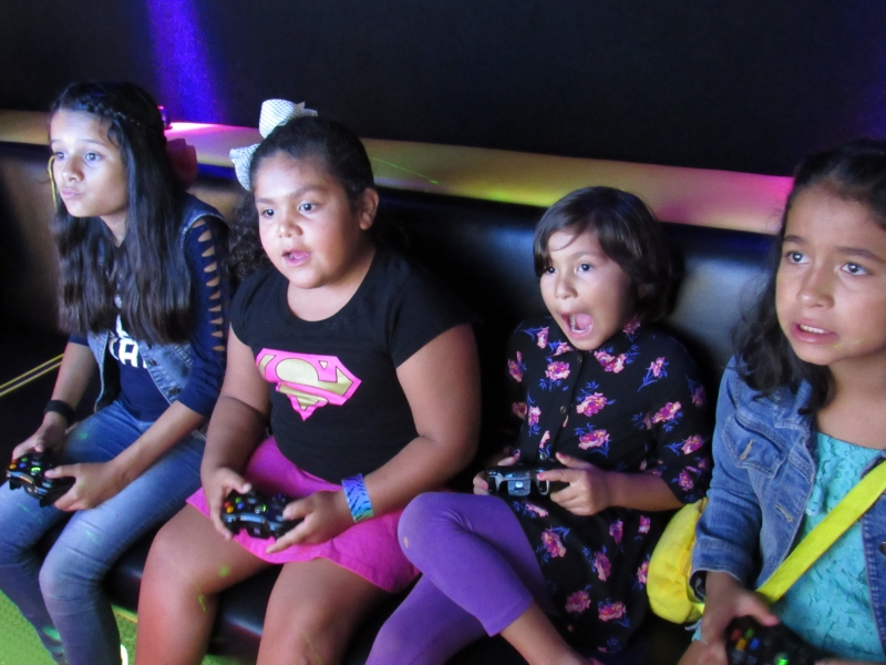 Girls playing video games in Mobile Alabama video game truck party